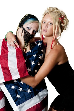 veiled: An Arab woman wrapped in an American flag Stock Photo
