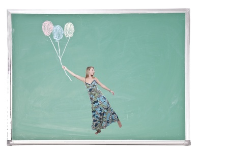 A beautiful young woman floating with balloons on a chalkboard photo