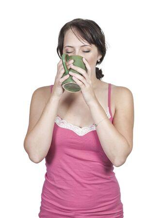 night shirt: A beautiful young woman drinking coffee in her pajamas