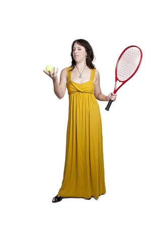 evening gown: A beautiful woman in an evening gown playing the sports game of tennis