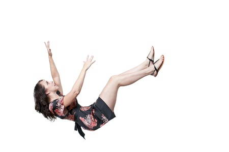 woman flying: A beautiful young woman falling through the sky
