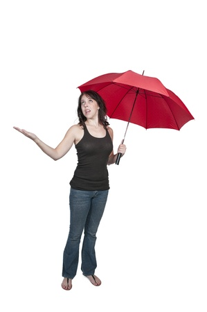 A beautiful young woman holding an umbrella in the rain Banque d'images