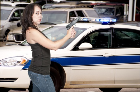 A beautiful police detective woman on the job with a gun Stock Photo - 10857564