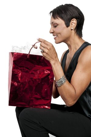 A beautiful woman holding a Christmas present Stock Photo - 10857654