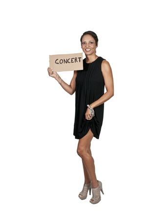 A beautiful woman with a sign hitch hiking to a concert Stock Photo - 10857906