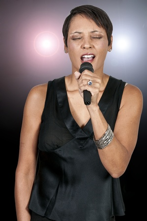 A beautiful woman singer performing at a concert photo