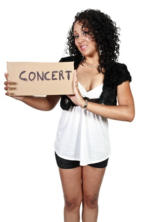 A beautiful woman with a sign hitch hiking to a concert photo