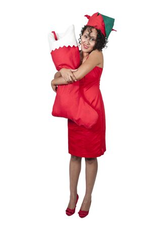 a beautiful woman elf holdin a big Christmas stocking photo