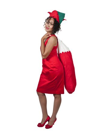 chirstmas: a beautiful woman elf holding a big Christmas stocking
