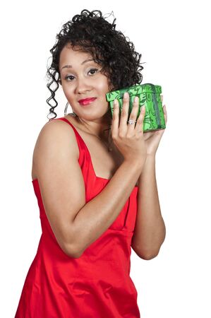 A beautiful young black woman opening a Christmas or birthday present photo