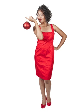 A beautiful young black woman holding a Christmas ornament photo