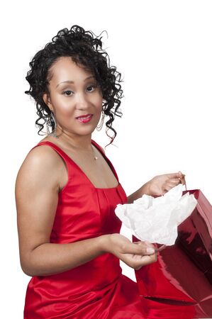 A beautiful young black woman opening a Christmas or birthday present Stock Photo - 10857782