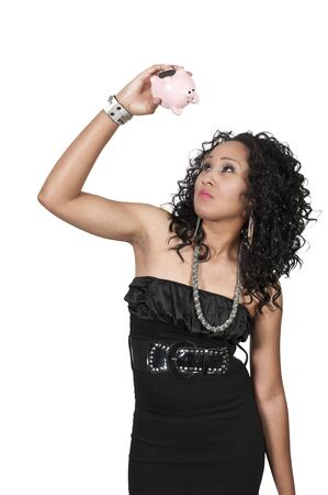 thrifty: A beautiful woman holding a piggy bank full of money she has saved