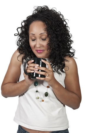 A beautiful young black woman drinking coffee. photo