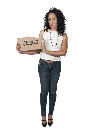 A beautiful young black woman holding up a Jesus sign photo