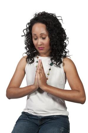 african worship: Beautiful Christian woman in deep prayer