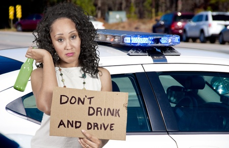 dont: Beautiful Woman Holding a Dont Drink and Drive Sign