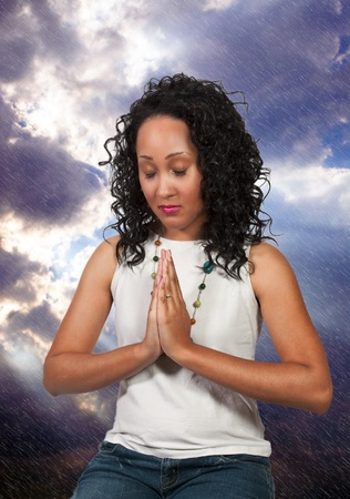 Beautiful Christian woman in deep prayer photo