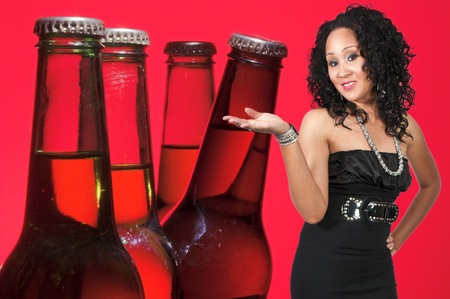 An beautiful black woman with the adult beverage known as beer photo