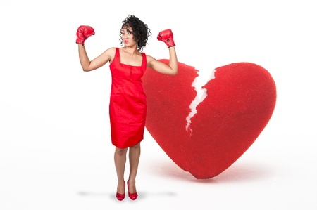 A beautiful young woman wearing a pair of boxing gloves Stock Photo - 10857452