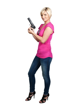 A beautiful police detective woman on the job with a gun Stock Photo - 10857501