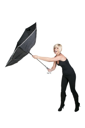 A beautiful woman holding a black torn umbrella photo