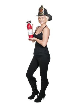 Een mooie vrouw brandweerman bij een brand Stockfoto