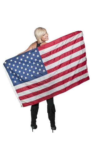 A beautiful young woman holding an American flag Stock Photo - 10857565