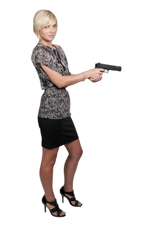 mujer policia: Una hermosa mujer detective de polic�a en el trabajo con una pistola Foto de archivo