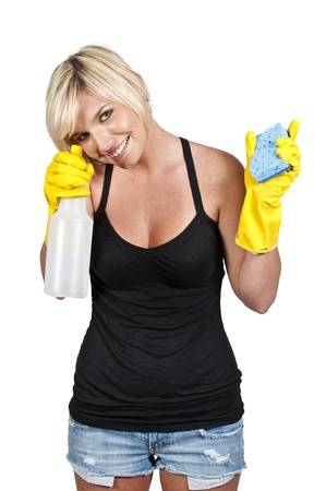 Aglove wearing beautiful woman or maid cleaning house with a sponge and spray bottle with cleaner Stock Photo - 10857605
