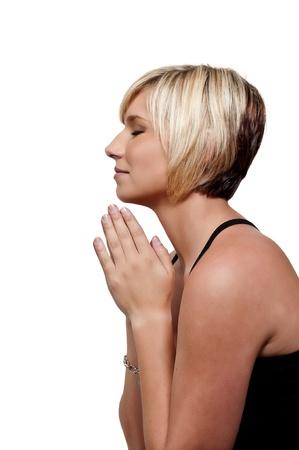 Beautiful Christian woman in a deep prayer Stock Photo - 10857806