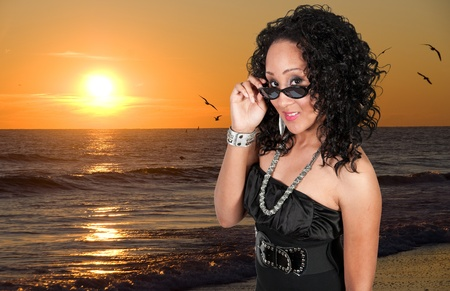 A black woman sporting a pair of sunglasses Stock Photo