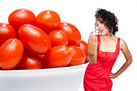 A beautiful young black african American woman inviting you to have some delicious garden variety cherry tomatoes