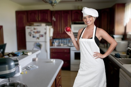 A young female woman chef showing her approval of the taste of food photo