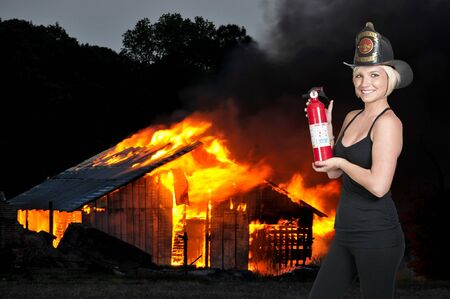 A beautiful woman firefighter at a fire Stock Photo