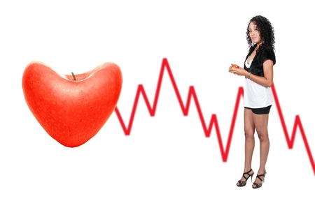 A beautiful African American woman holding an apple standing next to a heart shaped apple electrocardiogram Stock Photo