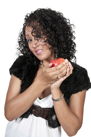 A beautiful African American woman holding an apple photo