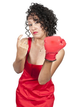 A beautiful young woman wearing a  boxing glove while motioning to come here photo