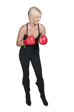 A beautiful young woman wearing a pair of boxing gloves Reklamní fotografie - 11171565