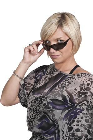 A beautiful woman wearing a pair of sunglasses photo