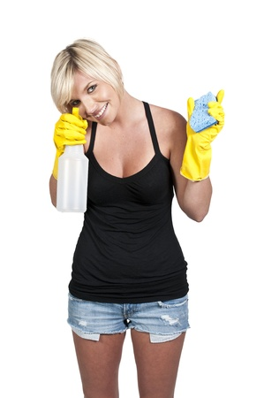 Aglove wearing beautiful woman or maid cleaning house with a sponge and spray bottle with cleaner Stock Photo - 11171817