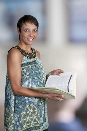 A beautiful young woman holding a manila file folder Stock Photo - 11172228