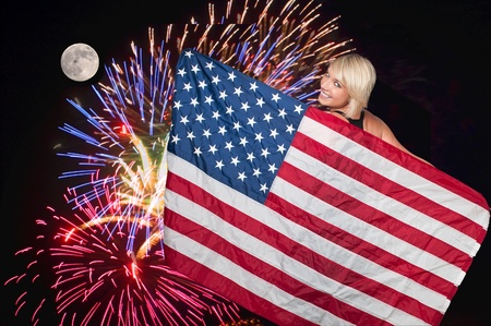 A beautiful woman at a fireworks display and a full moon.