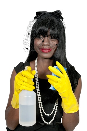 An African American glove wearing beautiful woman or maid cleaning house with a sponge and spray bottle with cleaner Stock Photo - 11172142