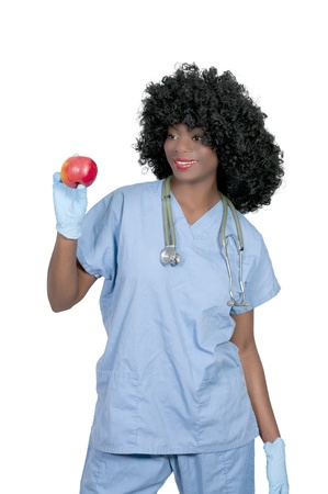 A beautiful female doctor in scrubs holding an apple photo