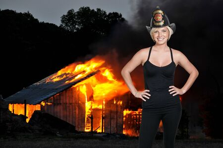 A beautiful woman firefighter at a fire photo