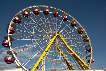 observation wheel: A large ferris wheel or big wheel at a fair. Editorial