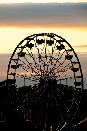 midway: A large ferris wheel or big wheel at a fair. Editorial