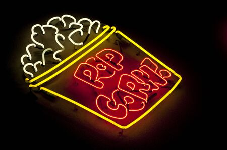 A bright and colorful neon popcorn light sign
