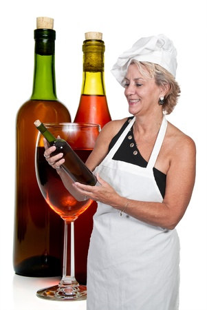 A beautiful woman holding a bottle of wine Imagens
